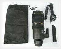 Ręczny odkurzacz, który wygląda jak obiektyw Nikon 70-200 mm. Kubki są już passé?