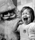 Dzieci na kolanach świętego Mikołaja