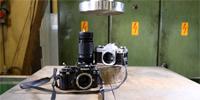 Nikon kontra Canon w prasie hydraulicznej